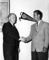 USAC President Louis Madsen shaking hands, early 1950s