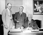 Rutger Walker with USAC President Franklin S. Harris and another man, circa 1950