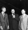 USAC President Louis L. Madsen speaking into a microphone, 1950s