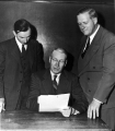 Wallace Vickers with USAC President Louis L. Madsen and another man, circa 1953