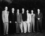 USAC President Louis L. Madsen standing with six other men, 1950s
