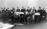 Group of men sitting at luncheon, circa 1915