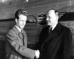 Desmond Anderson and Harold Stassen shaking hands, circa 1950