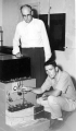 Professor and student working with a machine, circa 1957