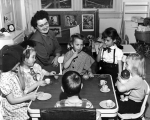Children playing 'tea party,' 1940s