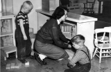 Woman and boys playing with blocks, 1940s