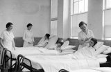 Three women providing nursing assistance, 1936