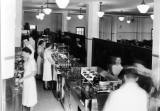 Serving counter of cafeteria, basement of the Family Life building, 1930s