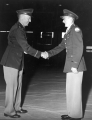 Two men in military uniform shaking hands