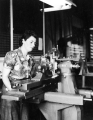 Woman running a lathe, 1940s
