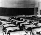 General classroom with fixed desks, circa 1920