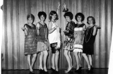 Six women in flapper outfits, 1958-59
