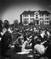"Students on the Quad during a rest break on ""A-Day,"" 1940"