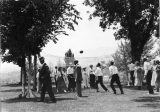 Group of men and women playing volleyball, circa 1915