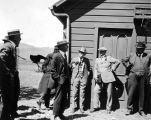 Men in front of building at Field Day activities at the Nephi Experiment Station Farm, circa 1924