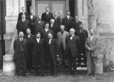 Men standing in front of Old Main, circa 1920