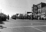 USU Band and performers marching down Main St. in Logan, 1950s