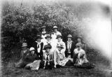 Twelve women posed outdoors, circa 1915