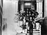 College band posed on the west entrance of the south wing of Old Main, circa 1904