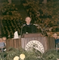 USU President Glen L. Taggart speaking at Commencement ceremony, circa 1971