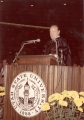 Bob Hope in academic robes speaking at Commencement exercises, early 1970s