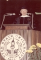 Man speaking at Commencement exercises, early 1970s