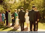 President Daryl Chase and Alice Chase greeting families at commencement, 1960s