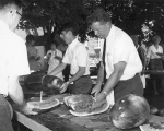 People serving watermelon, 1960s