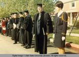 Robed faculty members along commencement procession, 1960s
