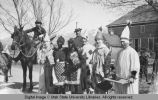 People dressed in clown costumes, March 20, 1915