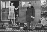 Family at the door of trailer, 1940s