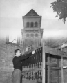Double exposure of student working the carillon, 1950s