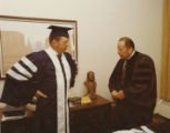 Snell Olsen and J. D. Harris in academic robes, Commencement Exercises
