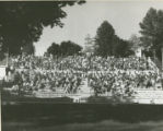 View of a large group of students filling the amphitheatre on Old Main Hill