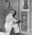 Wilford W. Richards painting flowers, 1950s