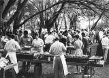 Filling up trays at a barbecue on campus, 1960s