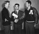 Garth Belliston and Nephi Schwab shaking hands, 1947