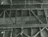 Detail of the first floor ceiling in the Registration Office showing the original framing and the...