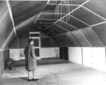 Woman inside a Quonset Hut