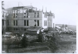 Old Main building, west section with center section under construction, early spring, 1902.
