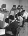 Students using microfilm readers, 1960s