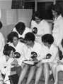 Group of women students, members of a campus service group called  SPURS, planning an activity,...