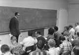 Professor teaching math to a group of students, 1960s