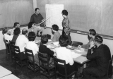 Professor teaching a group of students, 1960s