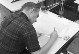 Student working at drafting board, 1960s
