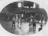 Basketball player taking taking a free-throw shot in Fieldhouse, 1917