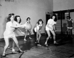 Women playing basketball in Smart Gymnasium, 1940s