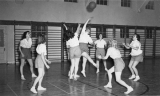 Women's basketball game in Smart Gymnasium, 1950s