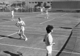 People playing tennis on courts near Edith Bowen School, 1960s