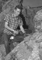 Male student chiseling a rock, 1960s